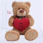 Urso de pelúcia grande com coração para namorada
